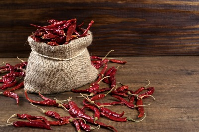 lose 10 pounds - bowl of red chili peppers